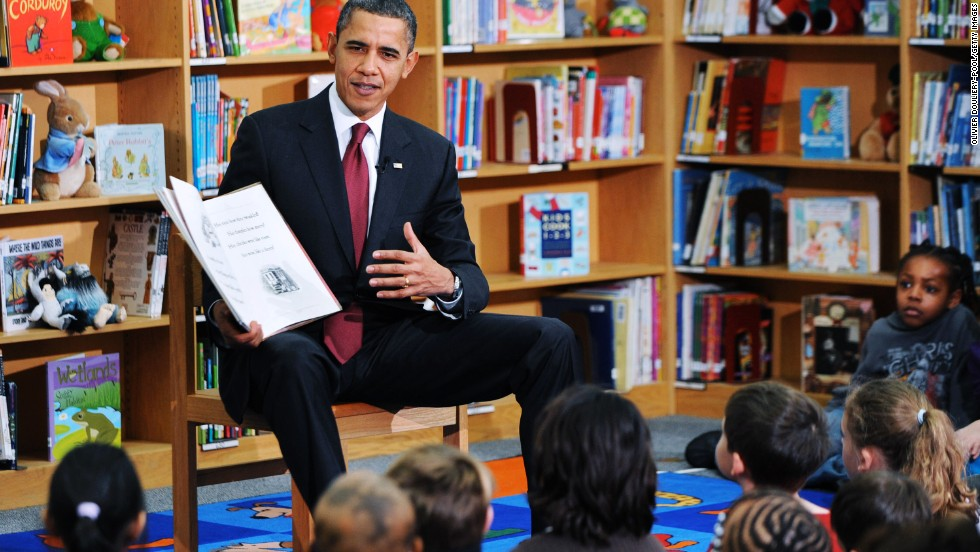 "President Barack Obama reads ""The Night Before Christmas"" to second-graders at Long Branch Elementary School in Arlington, Virginia, in December 2010."