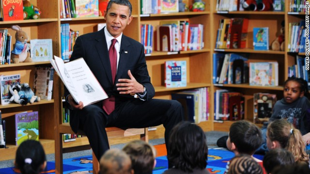"President Barack Obama reads ""Night Before Christmas"" to second graders at Long Branch Elementary School in Arlington, Virginia, in December 2010."