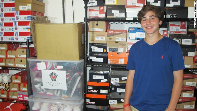 Nicholas Lowinger has a garage full of donated shoes at his family's home in Rhode Island.