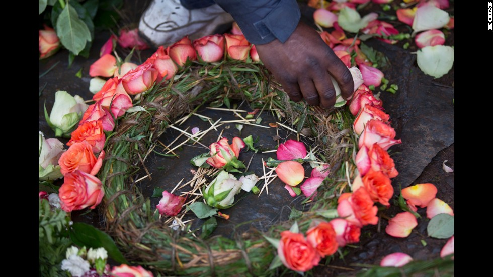 A street vendor makes floral wreaths outside a mortuary in Nairobi on September 25.