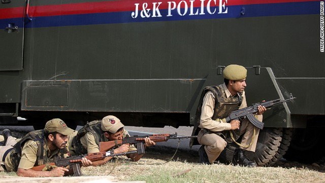 Indian police during an attack by militants on an army camp at Mesar in Samba District on September 26, 2013.