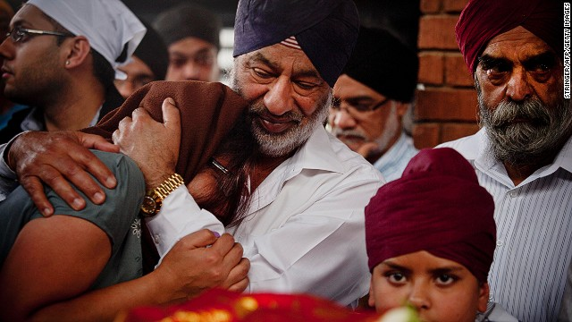 Mourners gather at the Sikh funeral of Dalvinder Kaur Ghataurhae and her grandson Pavraj Singh Ghataurhae, 16, at the Hindi Crematorium in Nairobi on September 25, 2013.