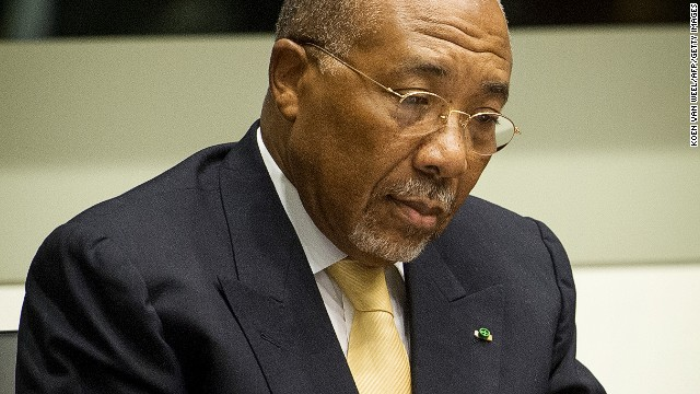 Former Liberian President Charles Taylor waits in the courtroom of the Special Court for Sierra Leone in The Hague prior to the appeal judgement on September 26, 2013.