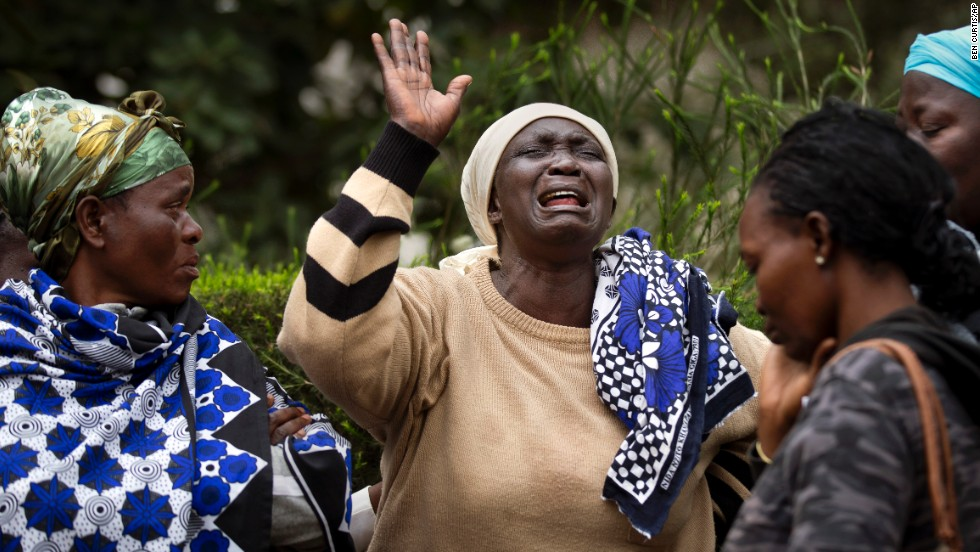 Mary Italo, center, grieves for her son Thomas Abayo Italo as they wait to receive his body at the mortuary in Nairobi on September 25.