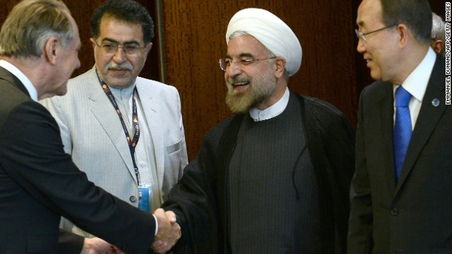 Iran's President Hassan Rouhani (C) arrives with UN Secretary-General Ban Ki-moon (R) during the 68th United Nations General Assembly, in New York, September 26, 2013. AFP PHOTO/Emmanuel Dunand (Photo credit should read EMMANUEL DUNAND/AFP/Getty Images)