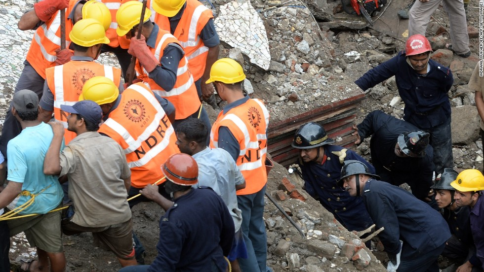 Firefighters look through a gap in the rubble as they search for survivors on September 27.
