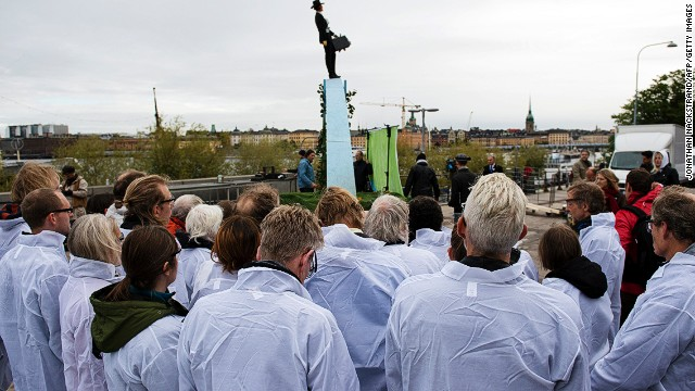 Activists gather outside the the United Nation's Intergovernmental Panel on Climate Change on September 27, 2013 in Stockholm.