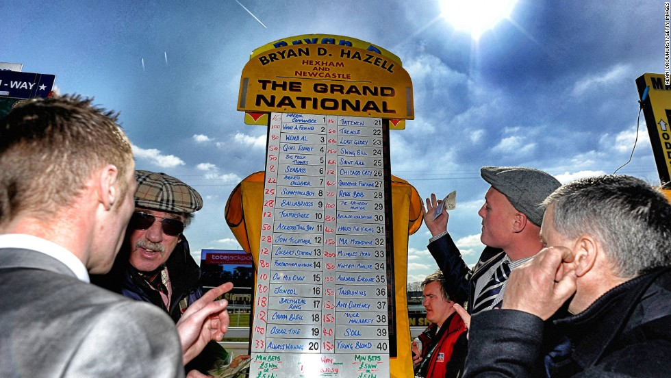 <strong>The Grand National, Aintree, Liverpool, UK: </strong>A bookmaker taking bets on the Grand National in April. The first official running of the world's most famous handicap steeplechase took place in 1839.