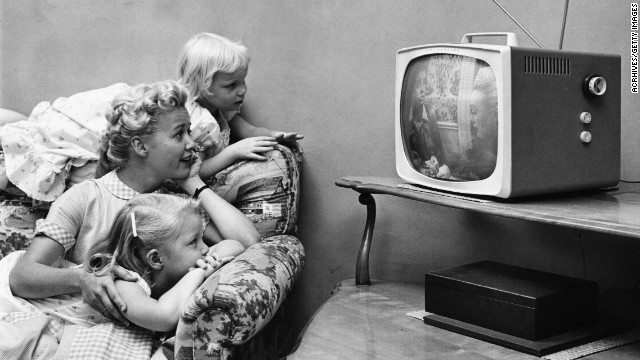 A family watching television in their home, circa 1955. Now viewing on tablets will factor into TV ratings.