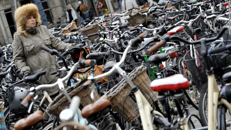 Don't be fooled by these stationary bicycles -- they're just resting. More than half of the city's population cycle to work and compete with cars not only in numbers but speed. Pedestrians beware -- or get on a bike.