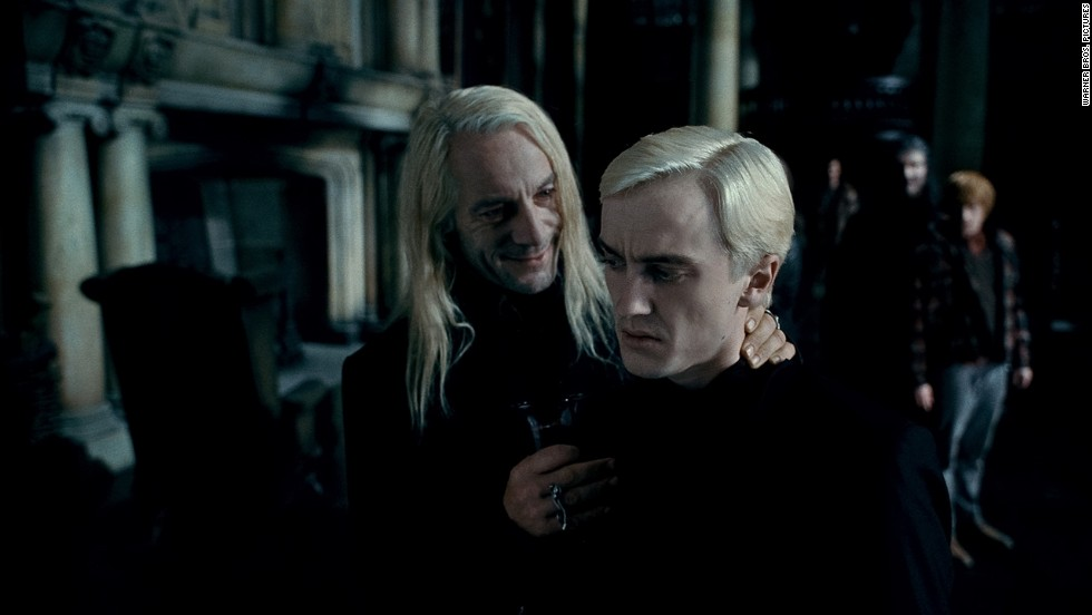 "Jason Isaacs, left, as Lucius Malfoy and Tom Felton as the mean and creepy Draco Malfoy in ""Harry Potter and the Deathly Hallows -- Part 1."""