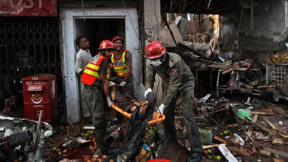 Rescue workers evacuate an injured man from a building at the site of the explosion.