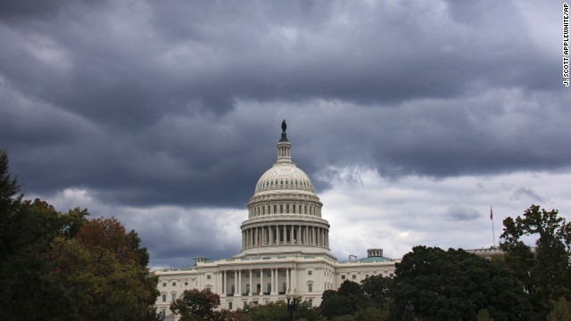 Dark clouds hang over the U.S. Capitol in Washington on Saturday, Sept. 28, 2013. A midnight Monday deadline is approaching for Congress to break an impasse over funding the government. In a rare weekend session, lawmakers from both parties urged one another to give ground in their fight over preventing a federal shutdown. (AP Photo/J. Scott Applewhite)