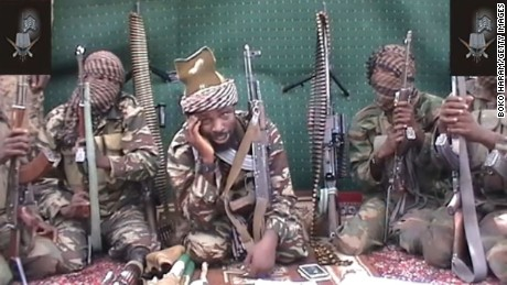 "A screengrab taken on September 25, 2013 from a video distributed through an intermediary to local reporters and seen by AFP, shows a man claiming to be the leader of Nigerian Islamist extremist group Boko Haram Abubakar Shekau. The video, which comes after an outburst of violence in northeastern Nigeria, shows the man taunting world leaders after the military said he may have been killed. RESTRICTED TO EDITORIAL USE - MANDATORY CREDIT ""AFP PHOTO / BOKO HARAM"" - NO MARKETING NO ADVERTISING CAMPAIGNS - DISTRIBUTED AS A SERVICE TO CLIENTS-/AFP/Getty Images"