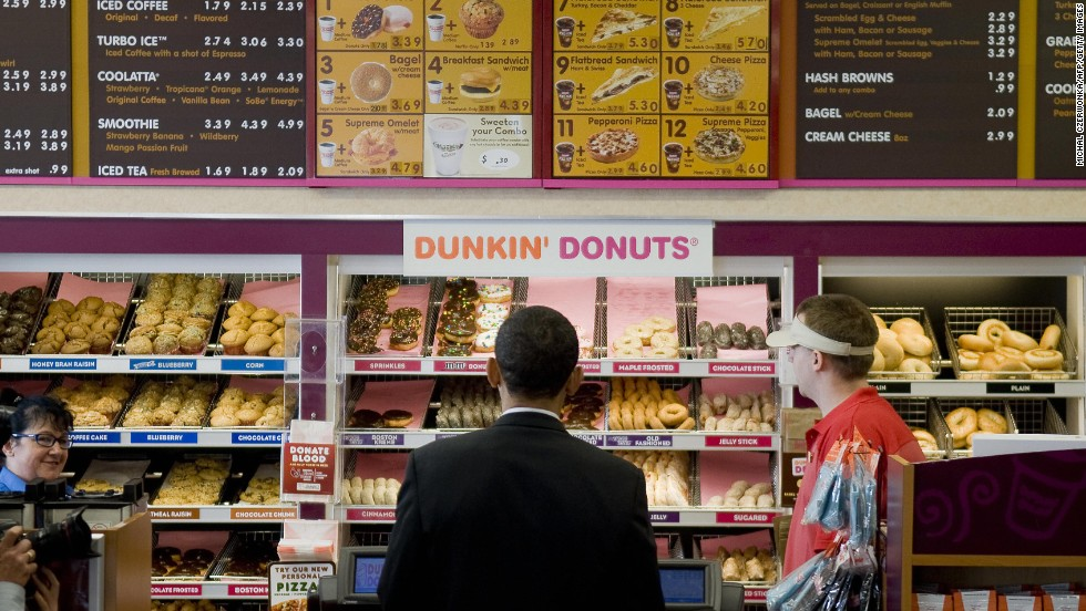 Like he doesn't have enough tough decisions to make each day -- DD, here visited by President Barack Obama in 2008, offers more than 100 flavors of donut, as well as cookies, bagels, sandwiches, baked goods, coffee, tea and chocolate.