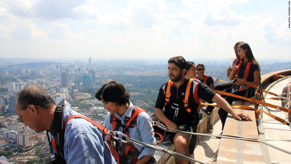 Spectators looking for their own thrills were attached to the KL Tower ledge with safety harnesses, allowing them to snap impressive photos of the jumps.