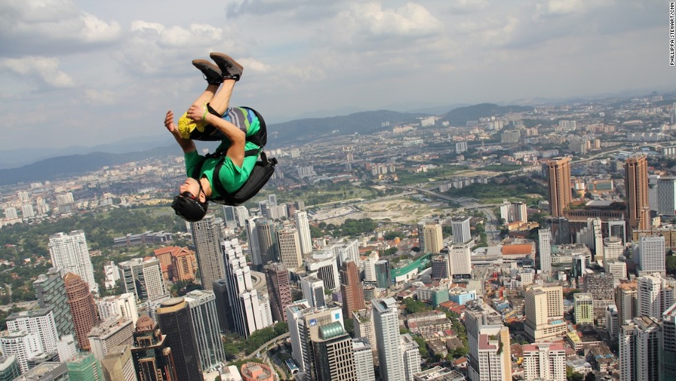 As if jumping off a tower wasn't frightening enough, this base jumper throws in a back flip.