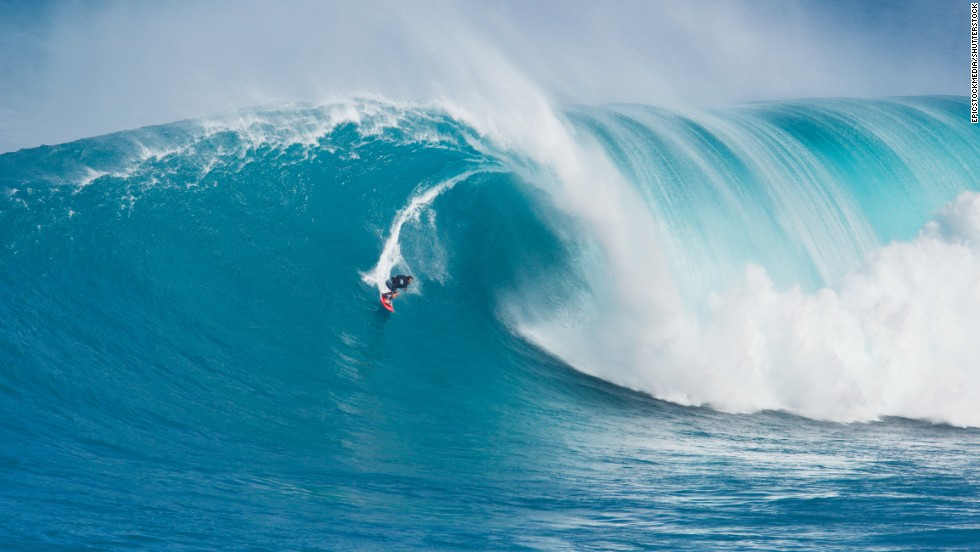 Waves as high as 60 to 70 feet have been reported at the Jaws surf break on Maui's North Shore. Professional surfer Billy Kemper is shown here catching a wave at Jaws on March 11, 2011.
