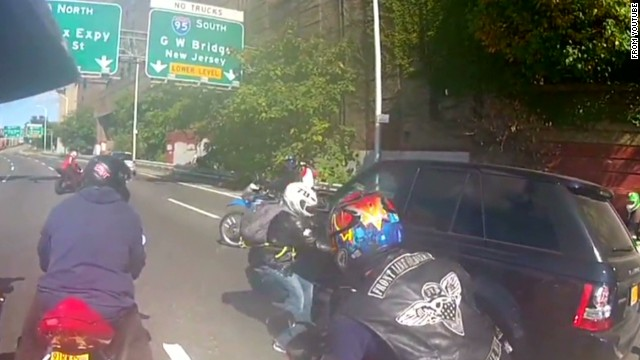 Video shows motorcyclists fighting driver