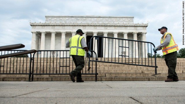 Members of the US Park Service close the Lincoln memorial on the National Mall October 1, 2013 in Washington, DC.The United States lurched into a dreaded government shutdown today for the first time in 17 years, after Congress failed to end a bitter budget row after hours of dizzying brinkmanship.     AFP PHOTO / Brendan SMIALOWSKI        (Photo credit should read BRENDAN SMIALOWSKI/AFP/Getty Images)