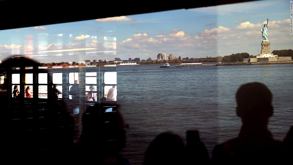 "OCTOBER 1 - NEW YORK, U.S.: People view the Statue of Liberty from the Staten Island Ferry. After weeks of bickering between the House and the Senate, the <a href=""http://www.cnn.com/2013/10/01/politics/government-shutdown/index.html?hpt=hp_t1"">U.S. government has officially shut down</a> for the first time in 17 years. Many government services are now closed,<a href=""http://www.cnn.com/2013/09/30/travel/shutdown-travel-national-parks/index.html?hpt=hp_c2""> including all National Parks</a>, such as the Statue of Liberty."
