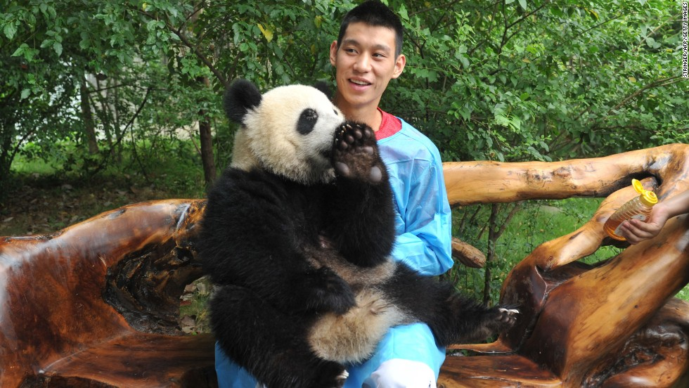 "Lin poses with a giant panda as he visits the Chengdu Research Base of Giant Panda Breeding in China on August 29. ""I'm always trying to have a good time, joking around, goofy,"" he said. ""I think I try not to take anything really too seriously."""