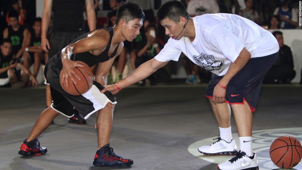 Lin, right, held a basketball clinic with young players in Taiwan in 2012. Lin remains one of few Asian-Americans in the NBA, and the first American of Taiwanese descent to play in the league.