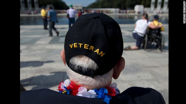 World War II Veteran George Bloss, from Gulfport, Miss., looks out over the National World War II Memorial in Washington, Tuesday, Oct. 1, 2013. Veterans who had traveled from across the country were allowed to visit the National World War II Memorial after it had been officially closed because of the partial government shutdown. After their visit, National World War II Memorial was closed again. (AP Photo/Carolyn Kaster)