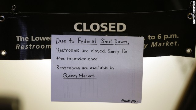 A hand-written sign informs visitors to Faneuil Hall, the nation's oldest public meeting hall, that restrooms are closed as a result of the partial government shutdown in Boston, Mass., Tuesday, Oct. 1, 2013. A long-running dispute over President Barack Obama's health care law stalled a temporary funding bill, forcing about 800,000 federal workers off the job and suspending most non-essential federal programs and services. (AP Photo/Stephan Savoia)
