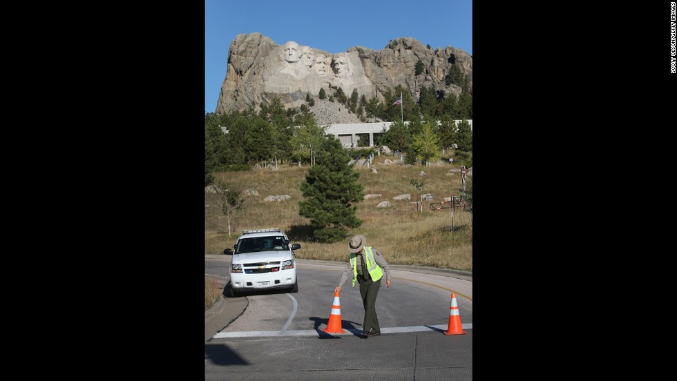 A park ranger secures a road at the entrance to the Mount Rushmore National Memorial on October 1 in Keystone, South Dakota.