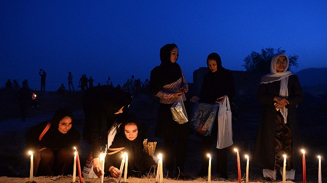 Afghan youth light candles in front of the destroyed palace of Darul Aman to mark the killing of 5000 civilians by the communist regime during the Russian occupation, in Kabul on September 29, 2013. Afghanistan began two days of official mourning for people killed by the communist regime in the late 1970s after a list of thousands of the dead was released. AFP PHOTO/ Massoud HOSSAINIMASSOUD HOSSAINI/AFP/Getty Images