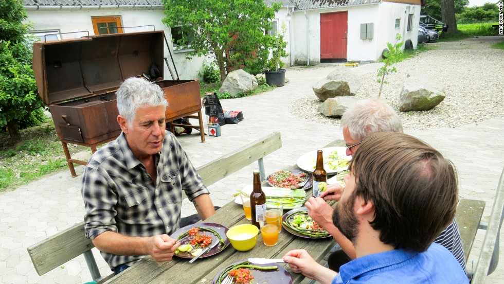 Bourdain, Redzepi and Wiuff sit down to a lunch of veal tartare with grilled wild onions and asparagus.