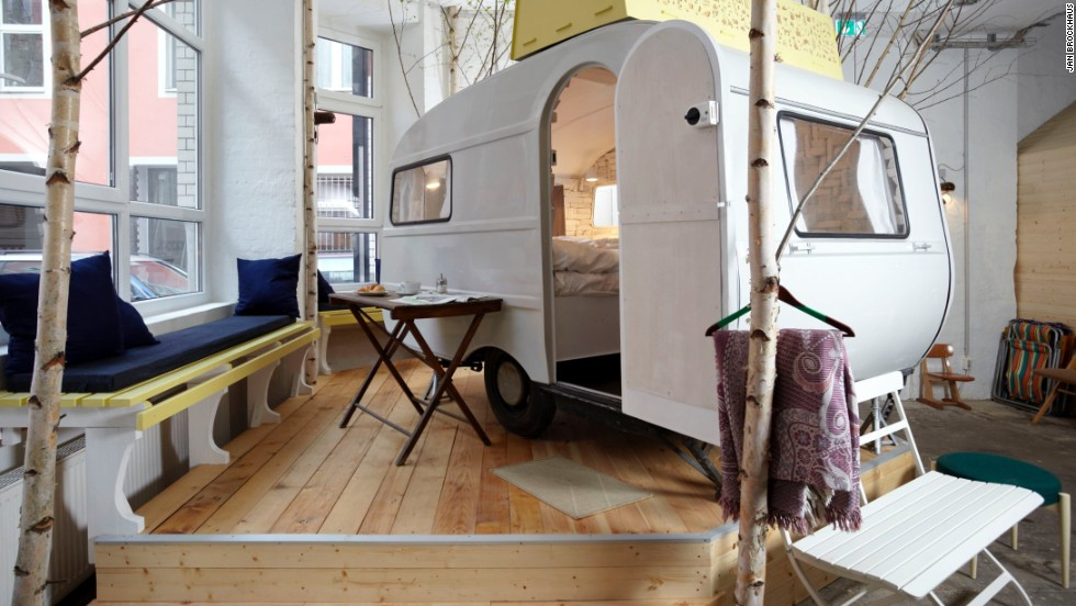 Housed inside a former vacuum cleaner factory, Hüttenpalast has a selection of fully furnished wooden huts and retro campers -- all under one roof.