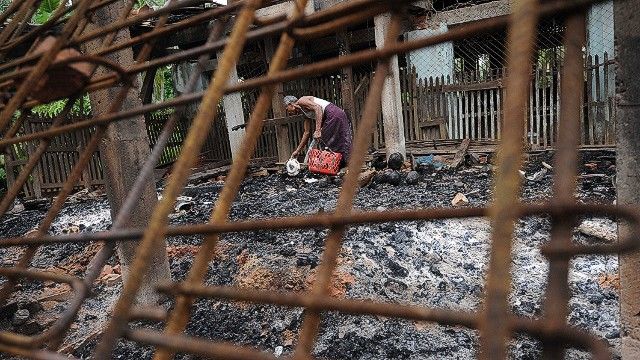 A man salvages items from the burnt area of a mosque following communal clashes in Thabyu Chi village near Thandwe, in Myanmar's western Rakhine state on October 2, 2013. Terrified women and children hid in forests and security forces patrolled tense villages in western Myanmar on October 2 as police said the toll from fresh anti-Muslim unrest rose to five. AFP PHOTO/SOE THAN WINSoe Than WIN/AFP/Getty Images