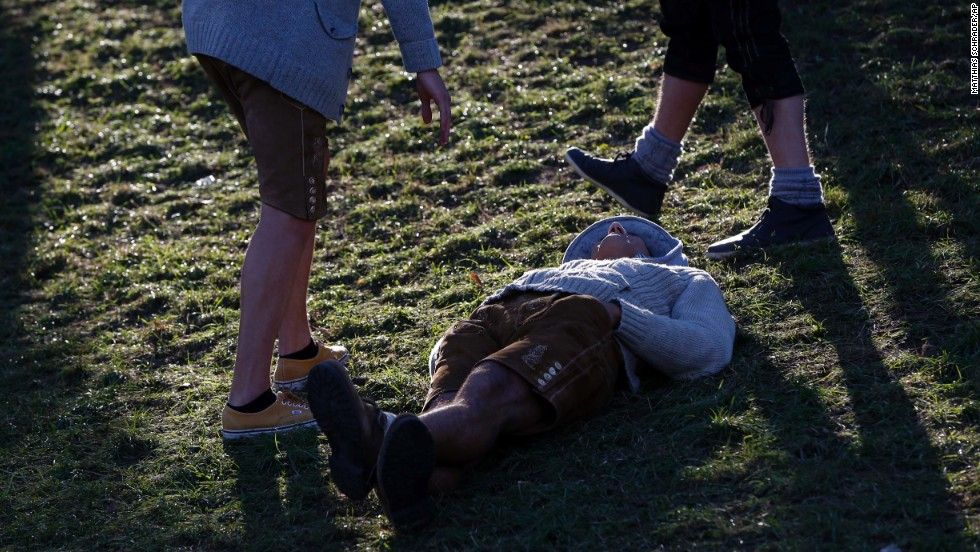 A man lays on the ground at the beer festival on October 2.