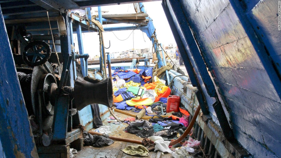 Migrants' belongings are scattered across the deck of a ship on October 3.