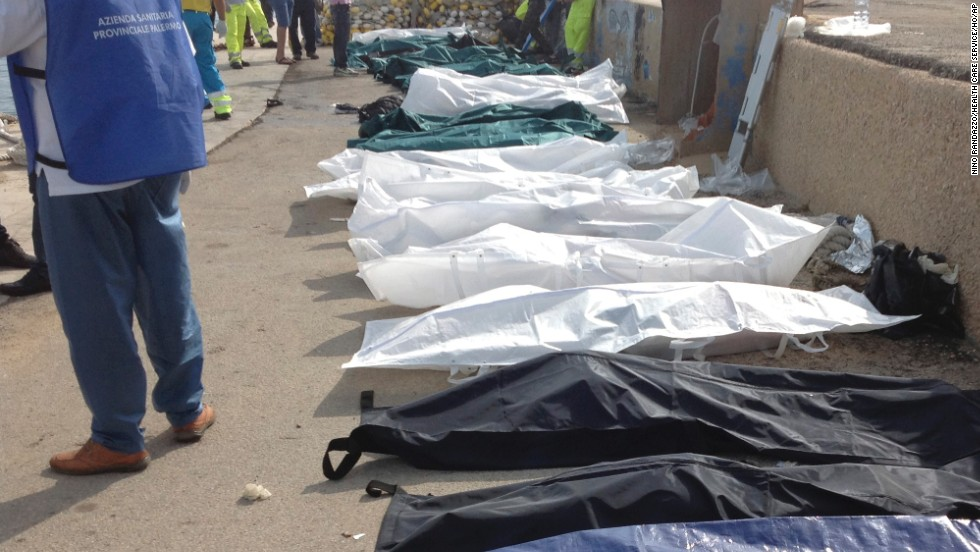 Bodies of drowned migrants are lined up at the port of Lampedusa on October 3.