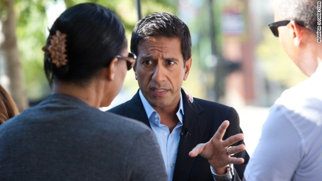 Dr. Sanjay Gupta talks about Obamacare with a couple in Greenville, South Carolina.