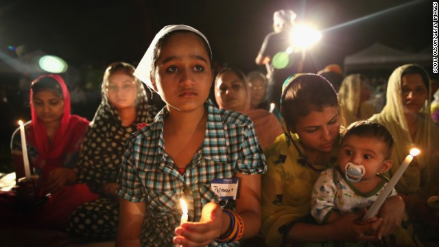 Palmeet Kaur, whose father was killed by a gunman at the Sikh Temple of Wisconsin, attends a vigil on August 5.