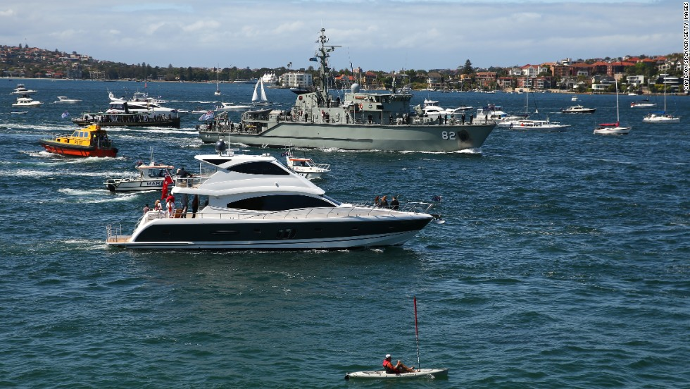 The HMAS Huon is escorted into the harbor by pleasure craft on October 4.