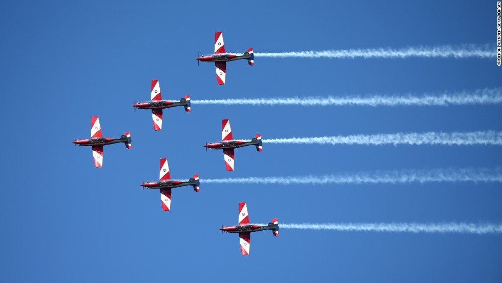 The Royal Australian Air Force Roulettes perform on October 4 as the ships arrive.