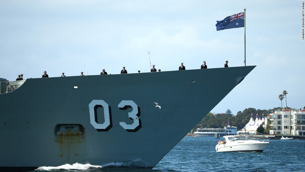 Crewmen are stationed topsid on October 4 as the HMAS Sydney arrives.