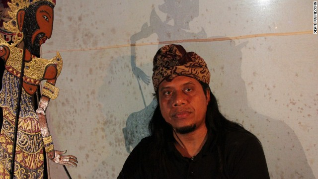 Made Sidia behind the shadow puppet screen.