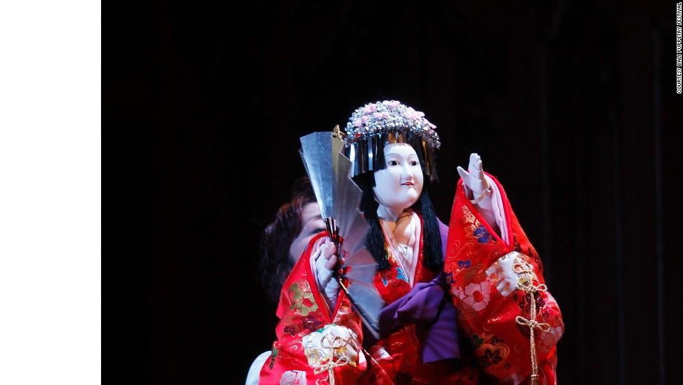 A Bunraku puppet performer from Japan.