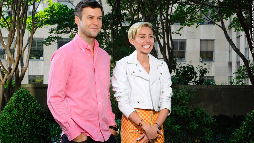 "Taran Killam and Cyrus pose in a promo for her upcoming ""Saturday Night Live"" episode on October 5."