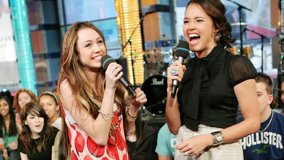 Cyrus chats with VJ Susie Castillo during an appearance on MTV's Total Request Live in February 2007 at MTV Studios in New York City.