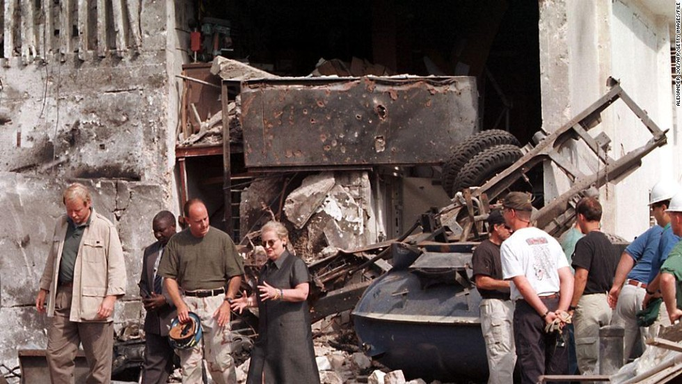 The Tanzania blast went off nearly simultaneously, to the one in Kenya on August 7, 1998, leaving 11 people dead. Here, U.S. Secretary of State Madeleine Albright talks with a member of the FBI at the U.S. Embassy in Dar es Salaam on August 18, 1998. Visible in the background is the tanker that was used to create the explosion.