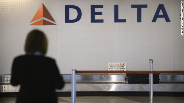A passenger waits for luggage in the Delta baggage claim at O'Hare International Airport in Chicago in October 2012.