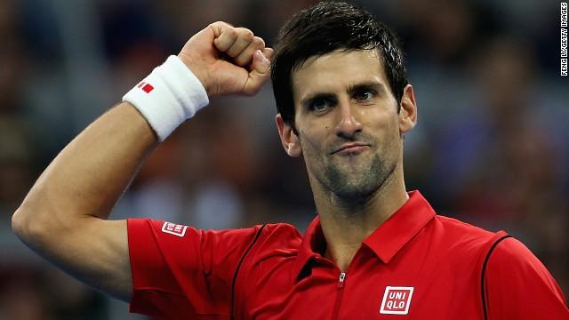 Serbian tennis star Novak Djokovic celebrates after beating Rafael Nadal in the China Open men's final in Beijing.
