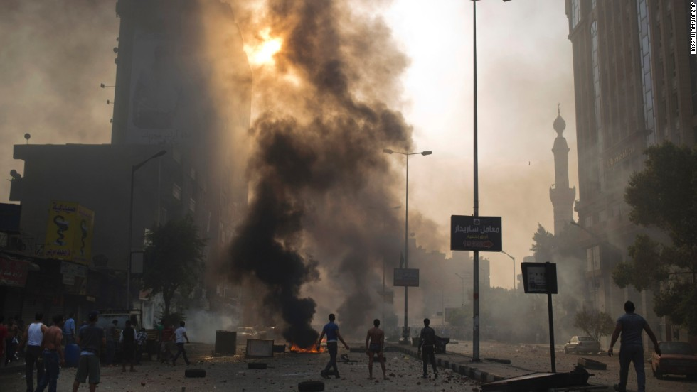 Supporters of ousted Egyptian President Mohamed Morsy clash with security forces in Cairo on Sunday, October 6. Protesters of the military-backed interim government took to the streets around the country, leaving more than 50 people dead and more than 260 injured, according to state media.